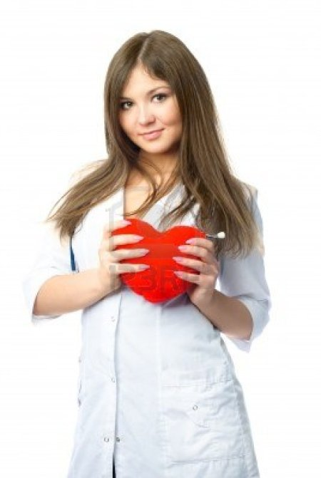 4520046-beautiful-young-cardiologist-with-a-heart-shaped-pillow-in-her-hands